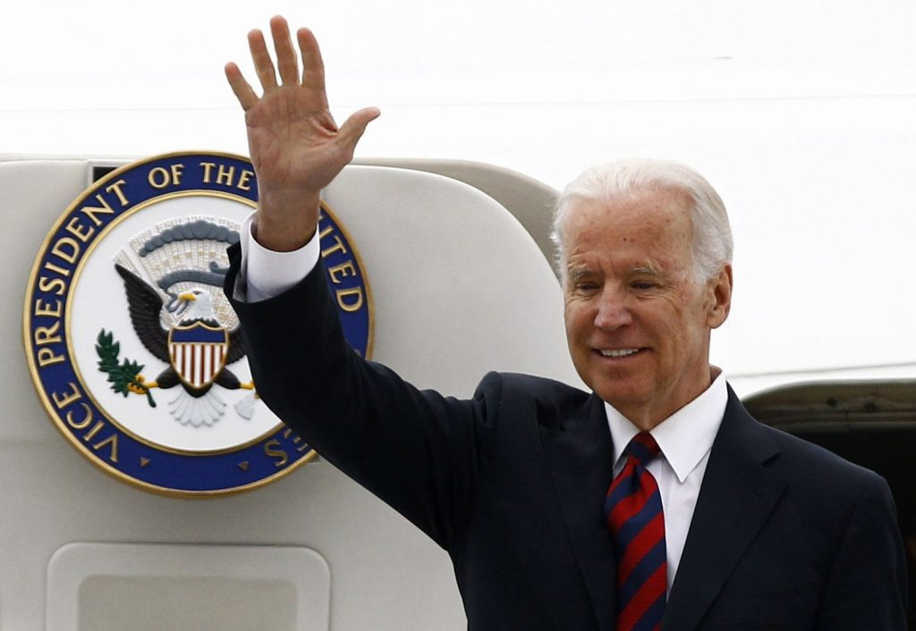 U.S. Vice President Joe Biden waves as he arrives at the Okecie military airport in Warsaw March 18, 2014. REUTERS/Kacper Pempel (POLAND - Tags: POLITICS)
